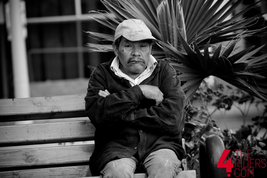 old man black and white sitting on bench mexico