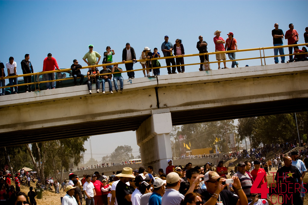 crowd at baja 500 watching from bridge